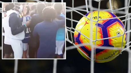 'Virus bomb': French medical official hits out at unsanctioned football match as 400 fans STORM PITCH (VIDEO)