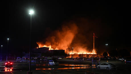 FILE PHOTO: A construction site fire during protests and riots near the Minneapolis Police third precinct in Minnesota, US, May 28, 2020