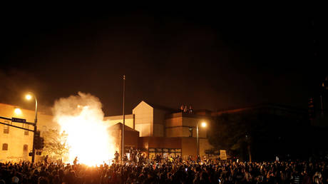 Protesters gather around after setting fire to the entrance of a police station in Minneapolis, Minnesota, US, May 28, 2020.