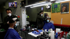 Shops, hair salons and bookstores reopen in Spain as rate of Covid-19 infections & deaths drop