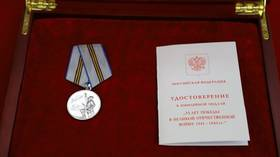 Kim Jong-un accepts WWII medal awarded by Putin days after DEATH rumors spread by Western media
