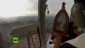 Virgin Mary image flown on HELICOPTER over Ecuador's Covid-19 hotspot as families struggle to bury the dead