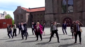 'They used to be Vikings': Norwegian PM & ministers earn praise & ridicule for festive dance video