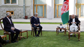 Taliban deal: US envoy meets Afghan president, former rival as Kabul ends political impasse