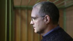 Russian prosecutors seek 18-year sentence for ex-US marine accused of espionage