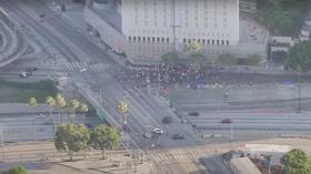 WATCH protesters block Los Angeles freeway, attack police cars as George Floyd rallies escalate into riots (VIDEOS)