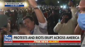 WATCH mob of protesters surrounding & shouting down Fox News reporter outside embattled WH