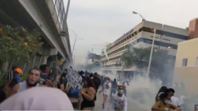 Riot police fire tear gas at protesters outside Miami Police Department (VIDEOS)