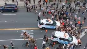 NYPD police cruisers RUN INTO crowds of protesters in terrifying video