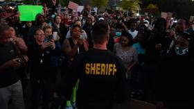 'It's not who we are!' County sheriff in Michigan JOINS march against police brutality