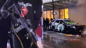 Rioter tries to LOOT AR-15 rifle from torched police car amid chaos in Seattle (VIDEOS)