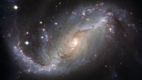 Patterns found in spiral galaxies indicate universe could be far more orderly than previously believed - rt