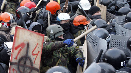 """""""Pro-European protesters"""" (note white supremacist symbols on shield) clash with Ukranian riot police in Kiev, January 19, 2014."""