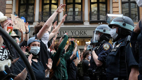 Demonstrators face police officers as they protest the death of George Floyd in Minneapolis police custody, in the Manhattan borough of New York City, June 2, 2020.