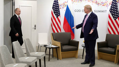 FILE PHOTO: Russia's President Vladimir Putin and US President Donald Trump mmet at the G20 summit in Osaka, Japan, on June 28, 2019.