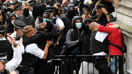 Protesters and police officers clash near Downing Street during a Black Lives Matter protest following in London, Britain on June 3, 2020.