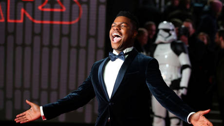 John Boyega poses for photographers as he arrives for the European Premiere of 'Star Wars: The Last Jedi' in London