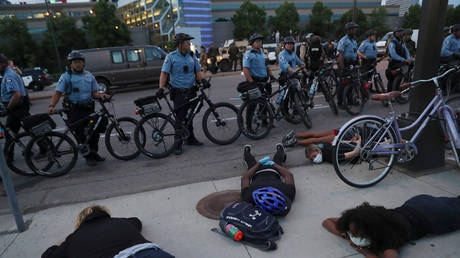Protesters lie down in front of police officers during a rally against the death of George Floyd, Minneapolis, Minnesota, May 31, 2020.