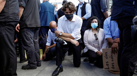 Canada's Prime Minister Justin Trudeau takes a knee during a rally against the death in Minneapolis police custody of George Floyd, on Parliament Hill, in Ottawa, Ontario, June 5, 2020.