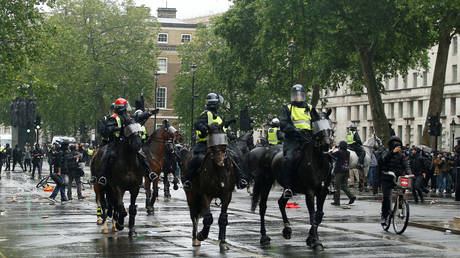 Police officers on horses react as police clash with demonstrators during a Black Lives Matter protest near Downing street in London