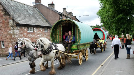 FILE PHOTO: Gypsies and travellers gather during the annual horse fair  in Appleby, Cumbria, UK, on 5 June, 2014.