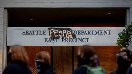 """Seattle Police Department's East Precinct sign, spray painted to replace """"police"""" with """"people"""" after the protesters established what they call an autonomous zone in Seattle, Washington, US"""