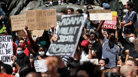 Demonstrators attend a protest against police brutality at the Place de la Republique square in Paris