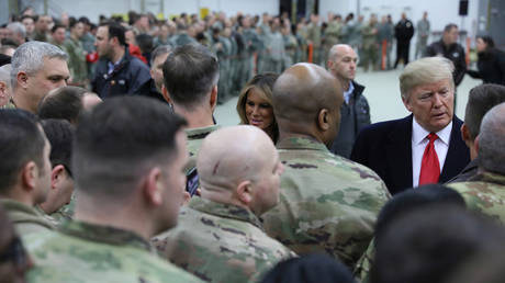 US President Donald Trump and first lady Melania Trump greet U.S. troops at Ramstein Air Force Base in Germany in 2018.  © Reuters / Jonathan Ernst