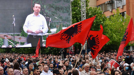 Ousted 'PM' of Kosovo Albin Kurti speaks to supporters who waved Albanian flags at a protest against the new government in Pristina, June 12, 2020.