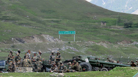 Indian Army soldiers on the way to Ladakh camp out with artillery near Baltal, southeast of Srinagar, June 16, 2020.