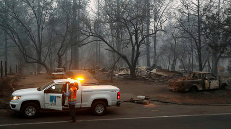 Employees of Pacific Gas & Electric (PG&E) work in the aftermath of the Camp Fire in Paradise, California, November 14, 2018.