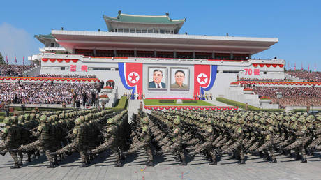 FILE PHOTO: North Korean soldiers march during a military parade marking the 70th anniversary of the country's foundation in Pyongyang.