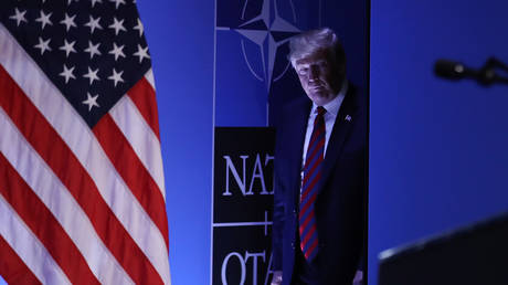 FILE PHOTO: U.S. President Donald Trump arrives to speak to the media at a press conference on the second day of the 2018 NATO Summit on July 12, 2018 in Brussels, Belgium