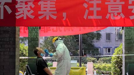 Man receives a nucleic acid test at coronavirus testing site in Beijing, China