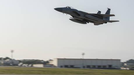A fighter jet takes off from Kadena Air Force Base © Global Look Press / ZUMAPRESS.com / Airman First Class Mandy Foster