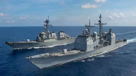 The Ticonderoga-class guided missile cruiser USS Bunker Hill (CG 52), front, and the Arleigh Burke-class guided-missile destroyer USS Barry (DDG 52) transit the South China Sea, April 18, 2020