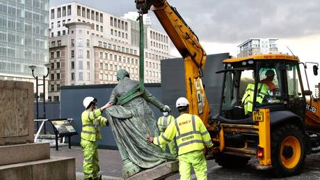 Municipal workers remove the statue of slave-owner and slave merchant Robert Milligan after a petition in West India Quay district of London, United Kindgom on June 09, 2020