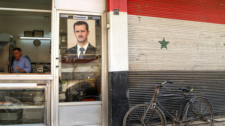 A picture of Syrian President Bashar al-Assad on a shop in Damascus, Syria April 22, 2020.