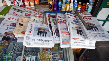 FILE PHOTO: Chinese newspapers.
