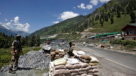India's Border Security Force (BSF) soldiers stand guard at a checkpoint along a highway leading to Ladakh, at Gagangeer in Kashmir's Ganderbal district