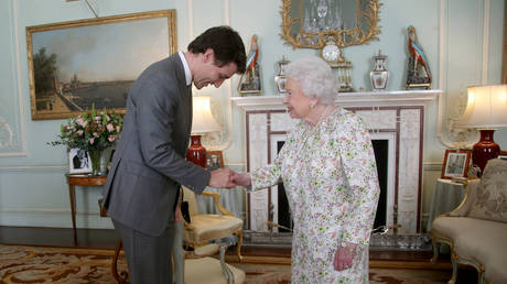 FILE PHOTO: Prime Minister of Canada Justin Trudeau is greeted by Queen Elizabeth II during a private audience at Buckingham Palace on April 16, 2018 in London, England