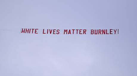 A White Lives Matter banner is flown over the Manchester City versus Burnley Premier League match. © Reuters
