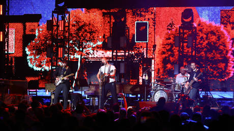 Jonny Buckland, Chris Martin, Will Champion, and Guy Berryman of Coldplay perform onstage at the 2020 iHeartRadio ALTer EGO at The Forum on January 18, 2020 in Inglewood, California