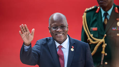 Tanzanian President John Pombe Magufuli gestures while arriving at the Loftus Versfeld Stadium in Pretoria, South Africa, for the inauguration of Incumbent South African President Cyril Ramaphosa on May 25, 2019