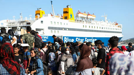 Refugees and migrants, who were given documents allowing them to move freely within Greece, wait to board a ferry to the mainland on the island of Lesbos, Greece, June 10, 2020