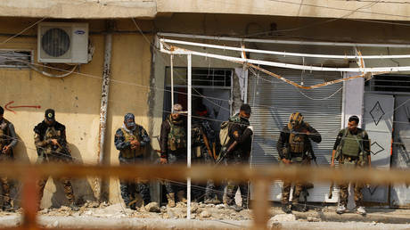FILE PHOTO: Iraqi federal police and special forces members