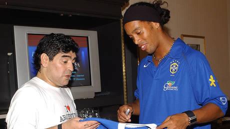 Ronaldinho and Diego Maradona - NILTON SANTOS / CBF / AFP