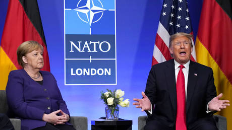 FILE PHOTO. Donald Trump and Angela Merkel during a bilateral meeting at the sidelines of the NATO summit in Watford, Britain. ©REUTERS / Kevin Lamarque
