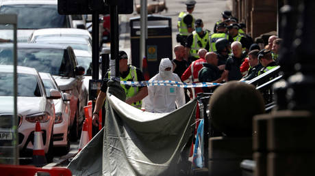 A forensic officer works at the scene of multiple stabbings at West George Street in Glasgow, Scotland, Britain on June 26, 2020.