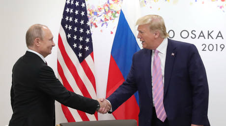 Vladimir Putin shakes hands with Donald Trump in meeting on the sidelines of the G20 summit in Osaka, Japan